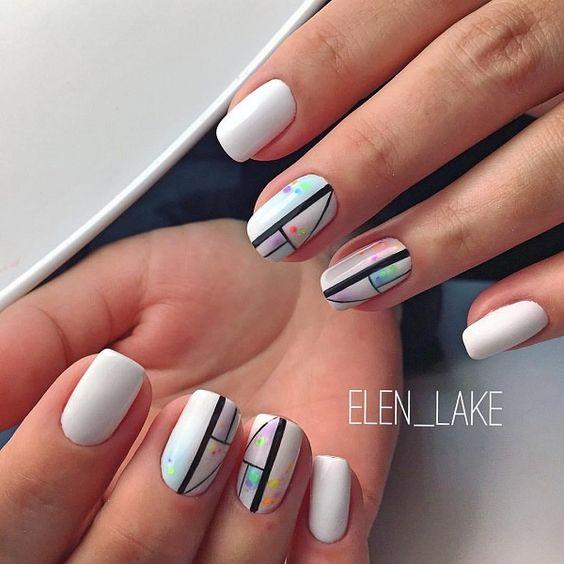 Białe paznokcie z wzorami