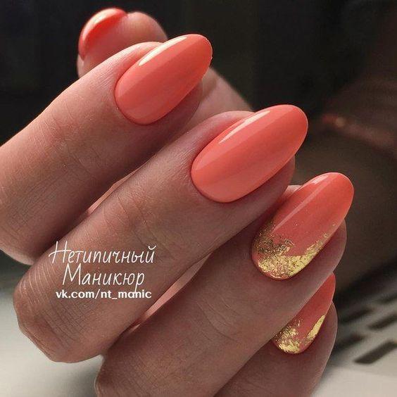 Pomarańczowe paznokcie ze zdobieniami