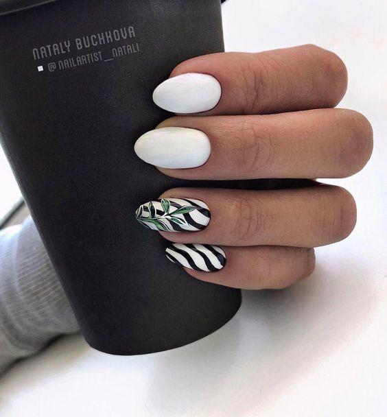 Białe paznokcie z liściem