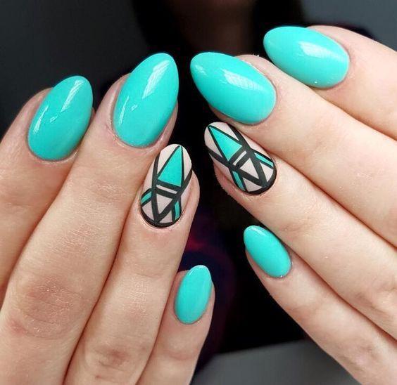 Turkusowe paznokcie z geometrycznymi wzorami