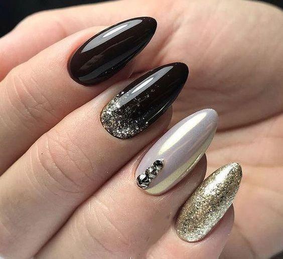 Czarno złote paznokcie na Sylwestra