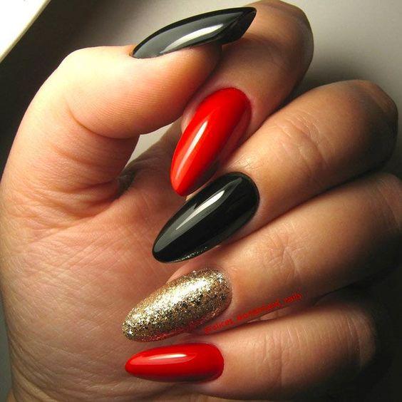 Czerwono czarno złote paznokcie