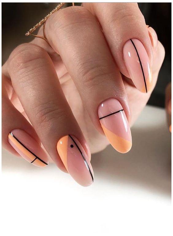 Pomarańczowe paznokcie z wzorkami na wiosnę