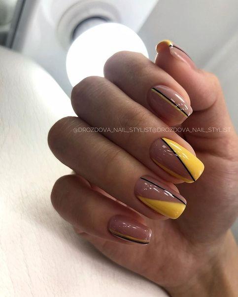 Żółte paznokcie z wzorkiem