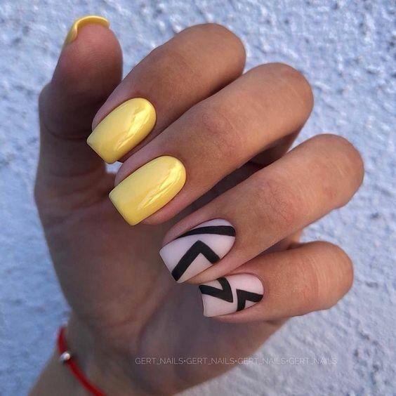 Żółte paznokcie z geometrycznymi wzorami