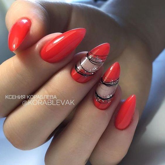Czerwone paznokcie ze zdobieniami do bordowej sukienki