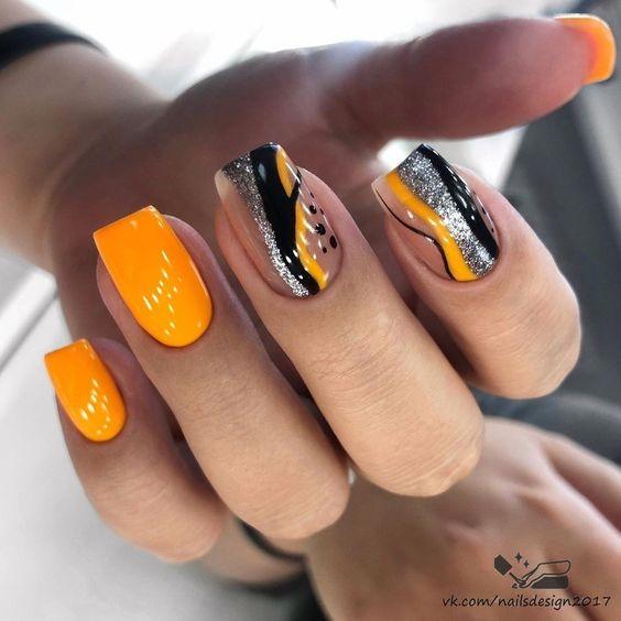 Neonowe pomarańczowe paznokcie z wzorkami