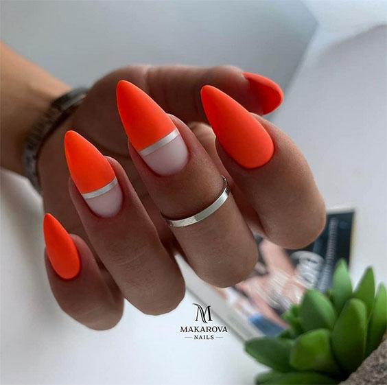 Neonowe pomarańczowe paznokcie